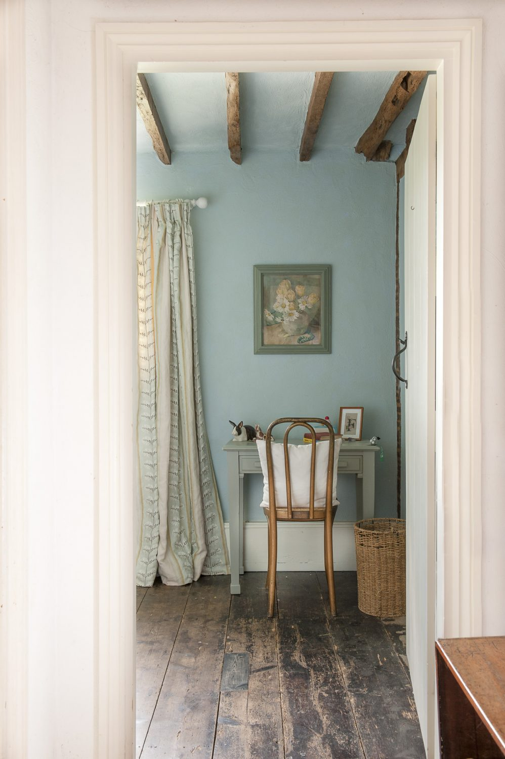 Daughter Flora's room is painted a tranquil chalky blue