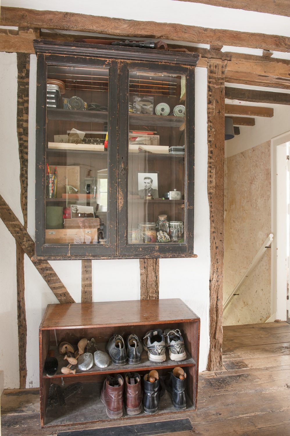 On the landing is a venerable glass-fronted cabinet displaying Nick's old fly fishing kit. The walls of the staircase up through the centre of the property are of attractive accidentally distressed plasterwork