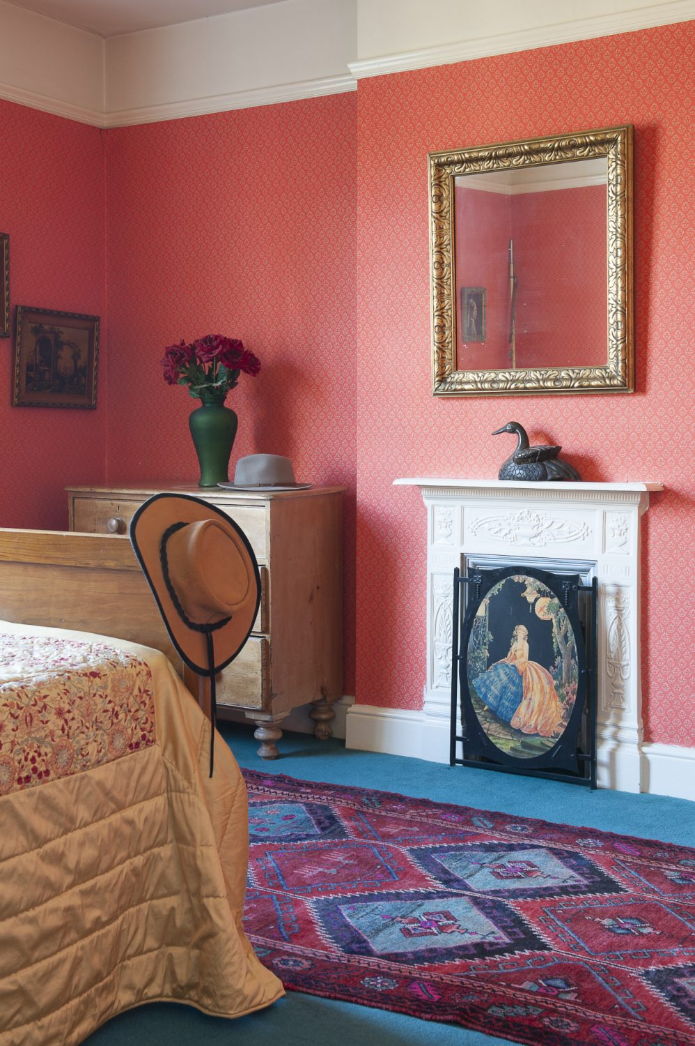 A warm and welcoming guest suite is home to an early Victorian bedspread with a superb gold satin counterpane that Louise found in a charity shop for £20