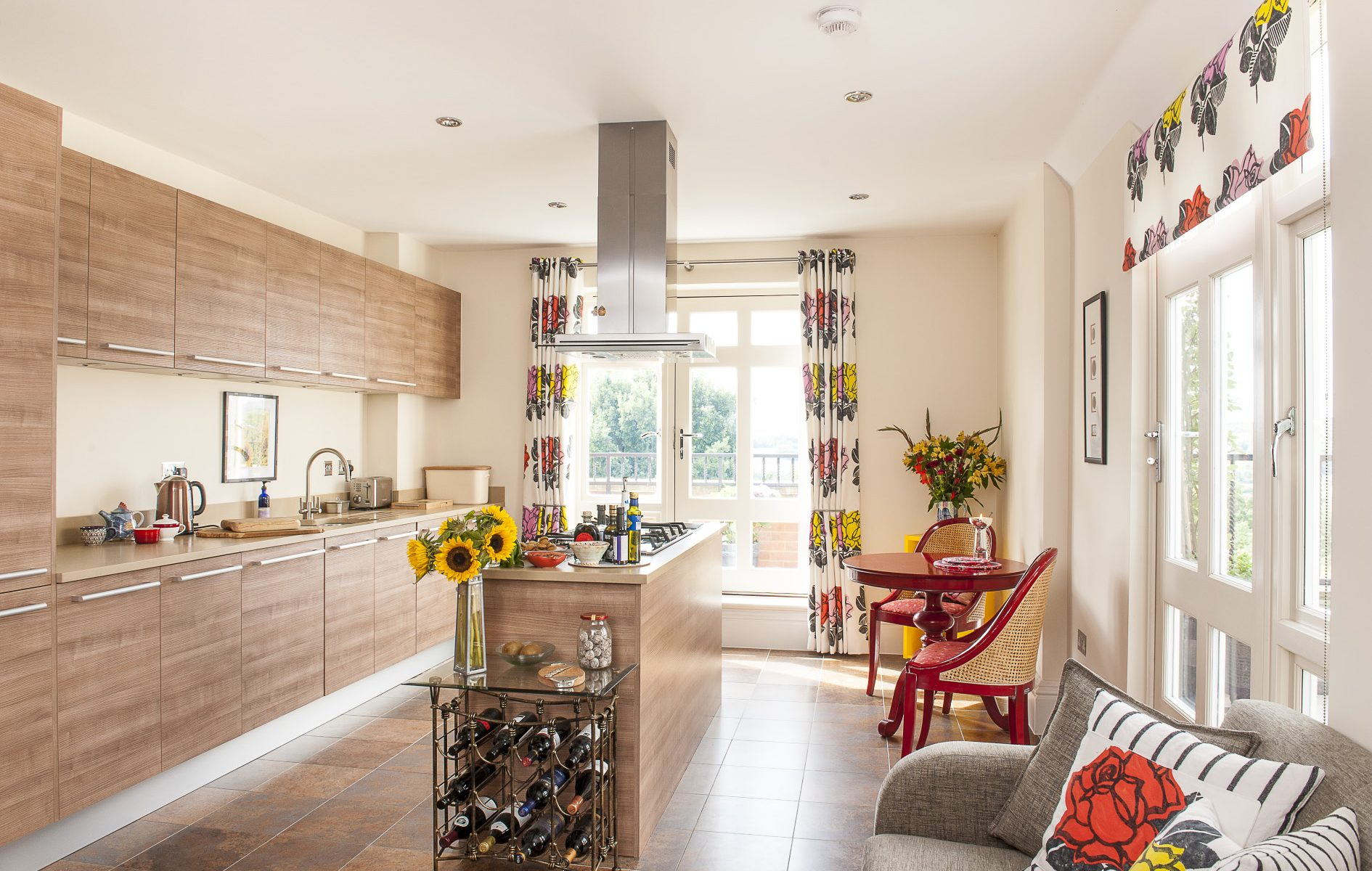 The state-of-the-art kitchen has been well thought out. It's light and spacious, boasting two sets of French doors, one leading onto a balcony, the other onto a small terrace, both with a wonderful Wealden view