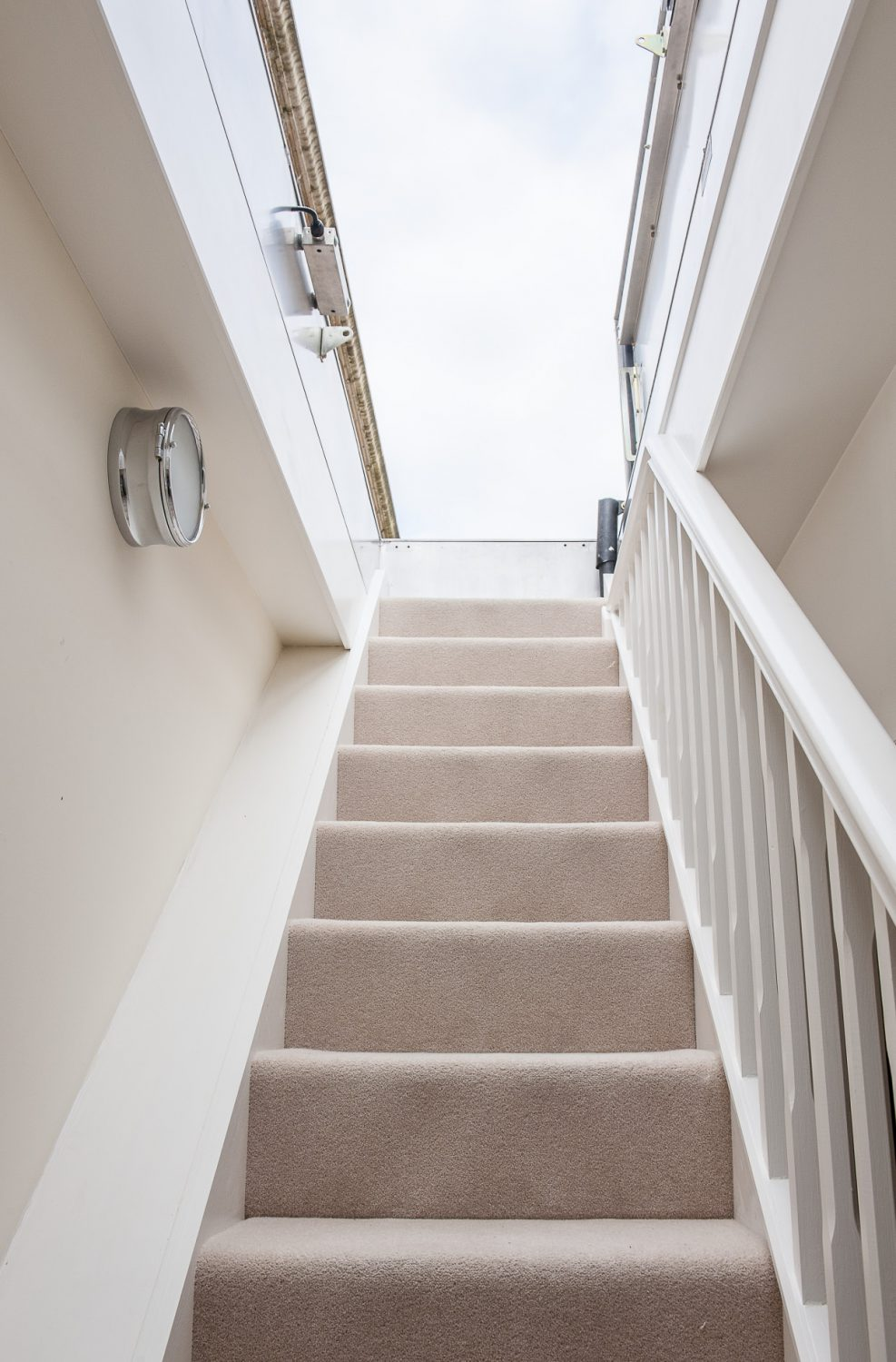 Stairs from the hallway lead up to the almost secret roof terrace which spans right across the top of the apartment