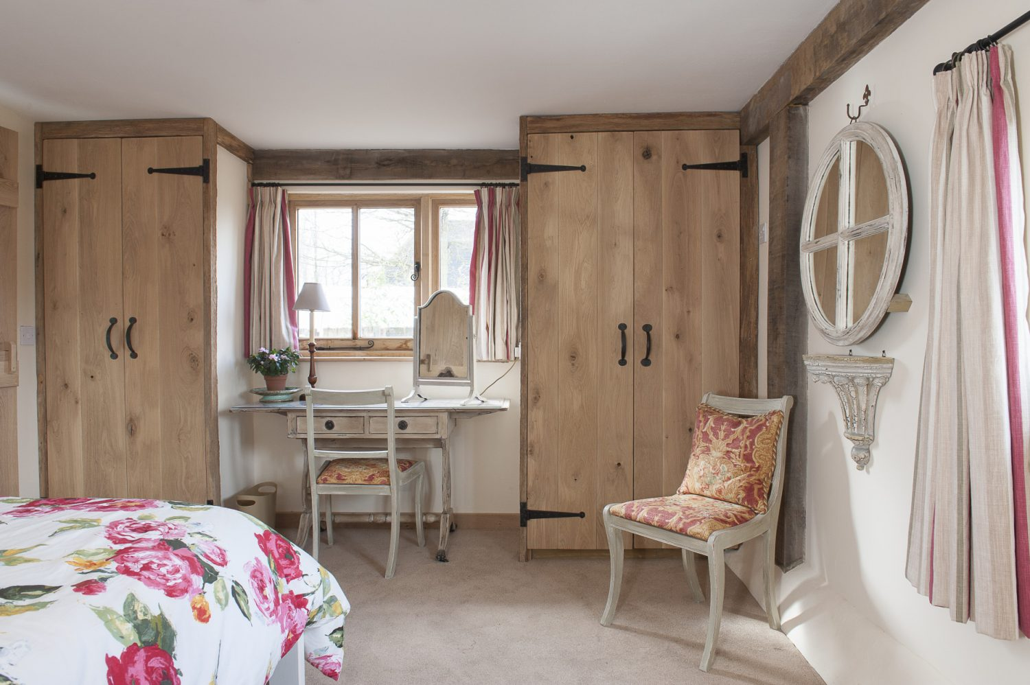 "In the main bedroom the old oak-doored built-in cupboards are spacious enough to conceal a regiment of foot. ""Just because you're on holiday it doesn't mean you don't need storage space,"" says Caroline..."