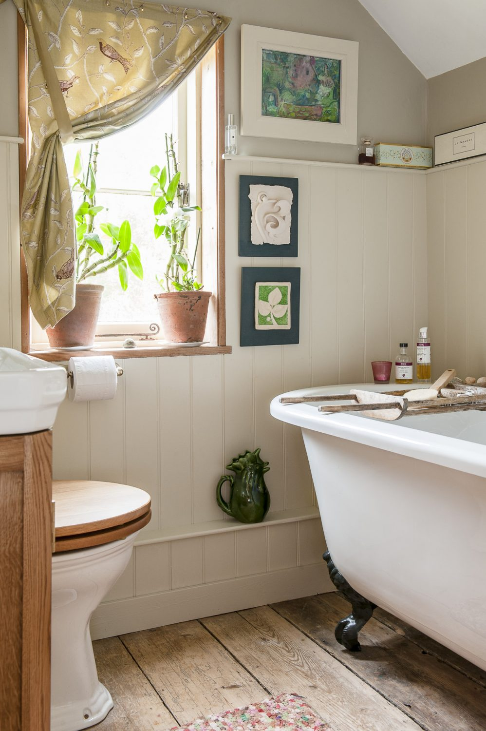At one end of the landing, the first floor bathroom features an elegant roll-top bath
