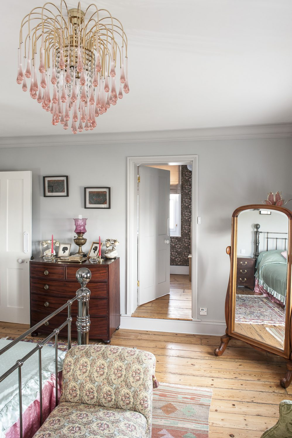 Off the landing is the couple's guest suite and its centrepiece, a large and unusual gun metal 'brass' bed. In a corner is a magnificent domed chest which once belonged to Manfred, whilst the walls are home to a collection of artist Helen Hunt's lepidopterology studies
