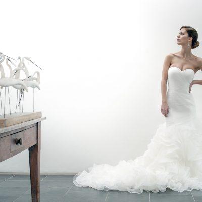 Pronovias Mildred dress, £1870, The Pantiles Bride, Tunbridge Wells 01892 514515 pantilesbride.com; Large crystal ball earrings, £30, Dark Horse Ornament, Faversham 07713 249604 darkhorseornament.co.uk