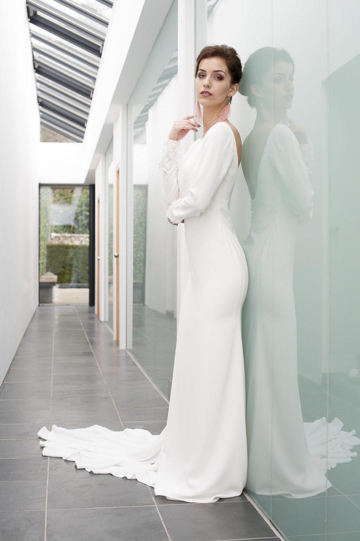 Pronovias Alana dress, £1600, The Pantiles Bride, Tunbridge Wells 01892 514515 pantilesbride.com; Blush feather drop earrings, £40, Dark Horse Ornament, Faversham 07713 249604 darkhorseornament.co.uk