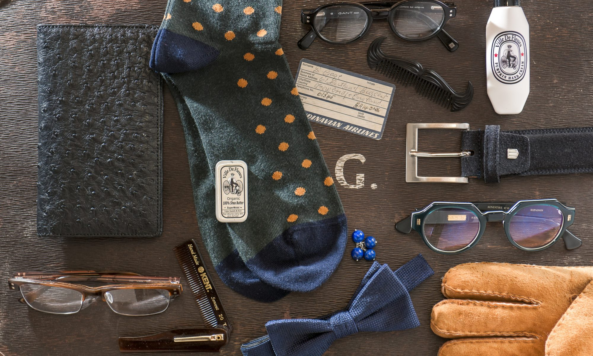 Black leather wallet, £135, Ostrich 2 Love www.wealdenfairs.com/ostrich2love; Gant dot socks, £13, Jeremy Hobbs Fine Menswear, Surrey 01932 865700 www.jeremyhobbs.co.uk; Pro Design brown frames, £175, Gant black frames, £120, Linda Pope Opticians, Hawkhurst 01580 753744 www.lindapopeoptician.co.uk; Kent men's folding pocket comb, £8.50, organic shea butter, £4.99, The Original Cowboy moustache comb, £9.99, Golden Pumpkin men's hand cream, £8.99, Ville De Fleurs www.wealdenfairs.com/villedefleurs; navy silk bowtie, £15, Profuoma suede navy belt, £39, County Clothes, Tenterden 01580 765159 www.countyclothesmenswear.co.uk; Lapis cufflinks, £25, Victorious Bee www.wealdenfairs.com/victoriousbee; men's merino sheepskin gloves, £39.99, Snugrugs www.wealdenfairs.com/snugrugs; Sinistre frames in 'Espadon' 2016, £299, RockOptika www.wealdenfairs.com/rockoptika