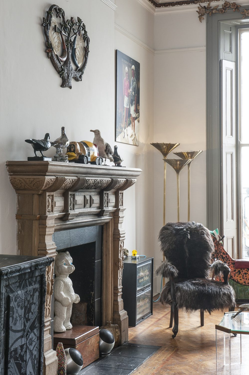 The focus of the room is still the original impressive fireplace although a previous owner has stripped it back to the bare wood and the couple have decided not to re-marble it