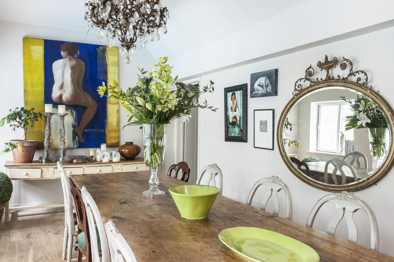 The long, high and bright dining room has more than a touch of orangery about it