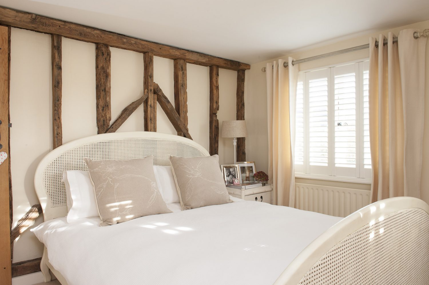 The master bedroom furniture is all from OKA including the lovely white rattan headed and footed bed and rattan and bamboo wardrobe and chest of drawers