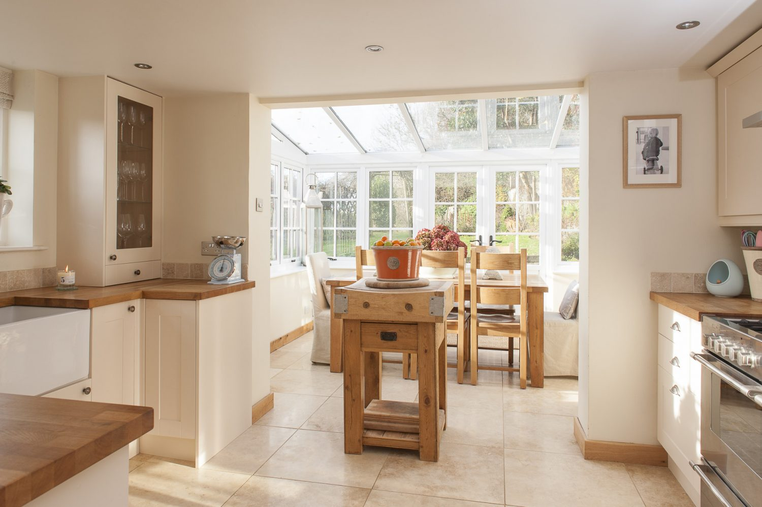 "Light pours into the spacious kitchen/conservatory but it was not always so. ""When we first saw it, the dining room had a small entrance into the conservatory,"" says Holly"