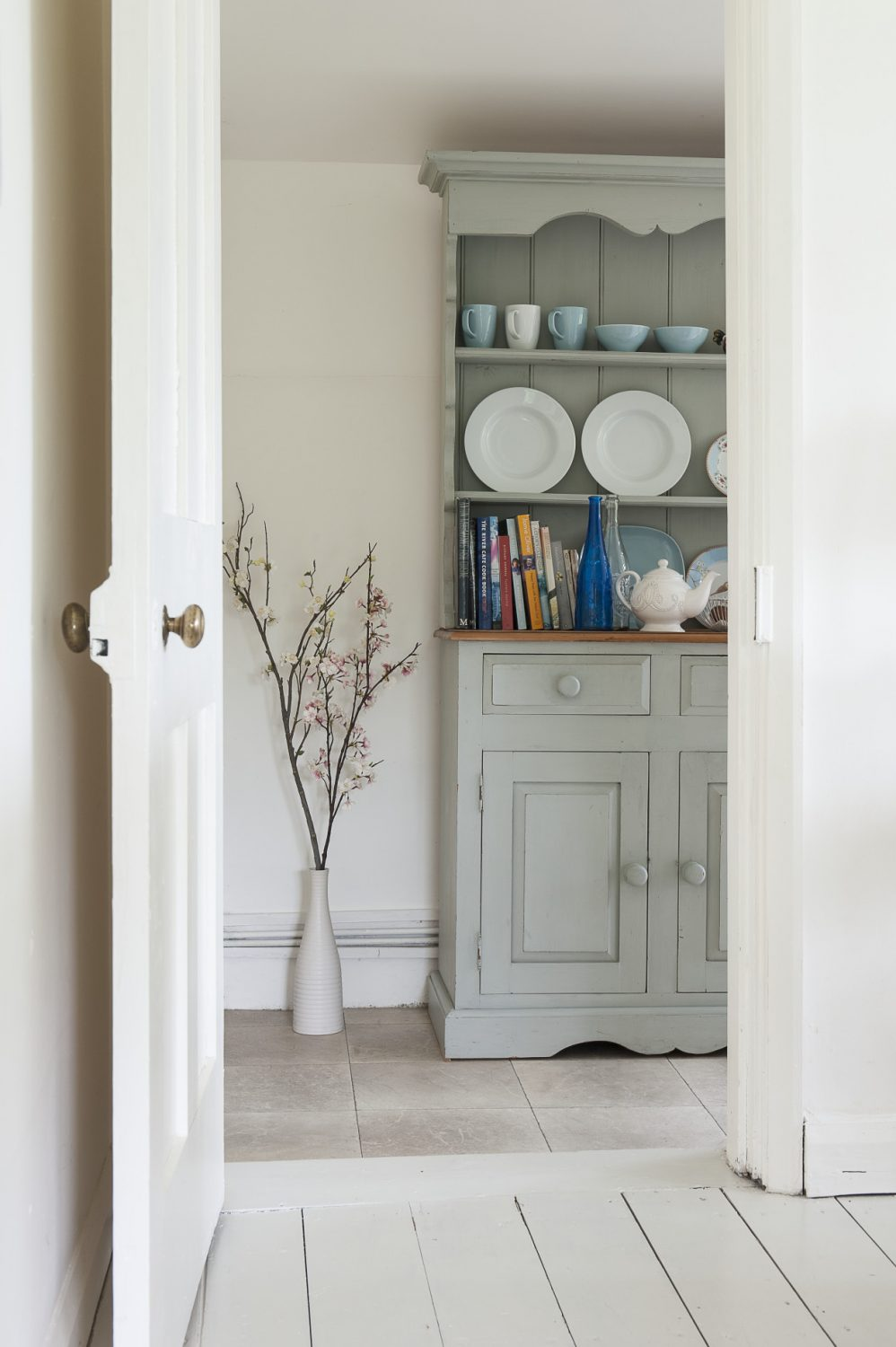 A door from the sitting room leads into the kitchen, which is surprisingly large for a small cottage
