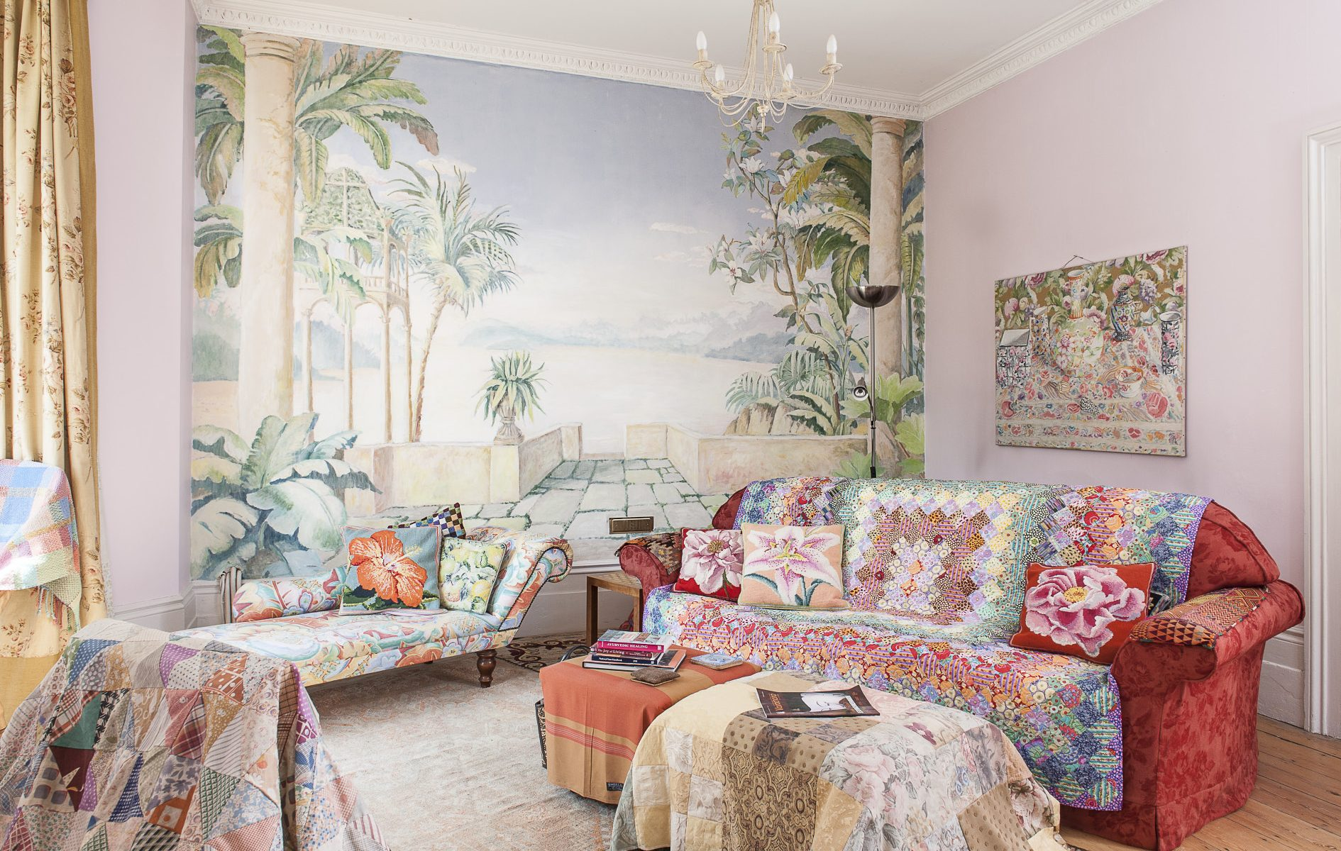 The living room alone is filled with countless examples of Kaffe's work, set against the most enchanting mural, which fills the entire end wall