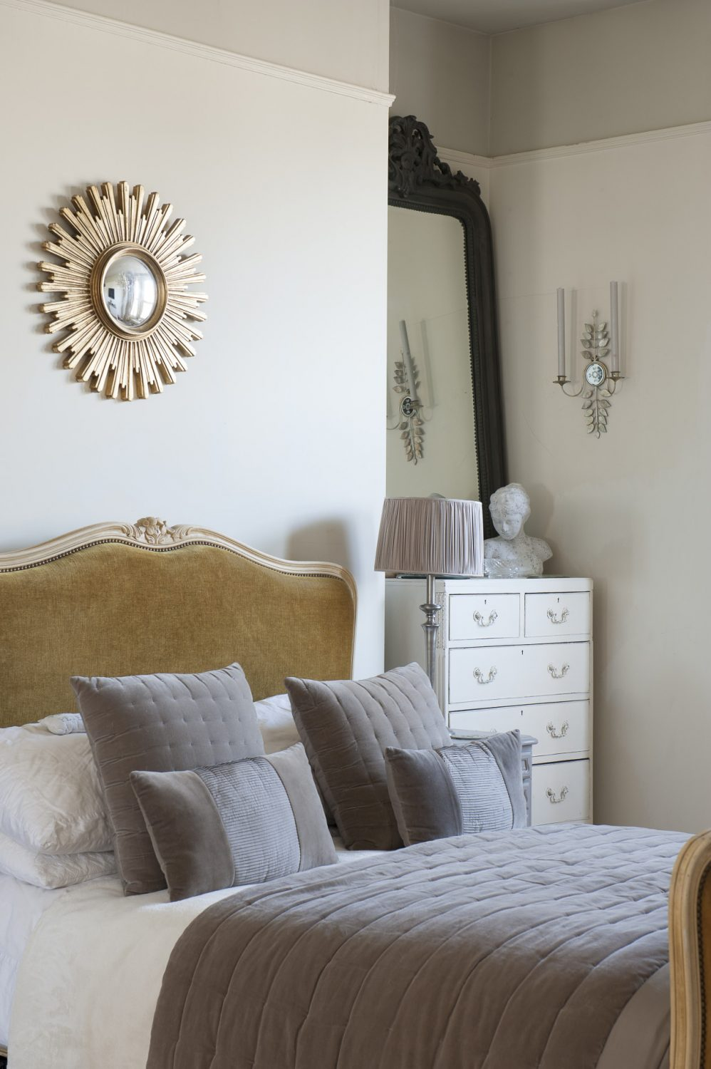 Centre-piece of the master bedroom is a large and elegant French corbeille bed over which hangs a 1950s sunburst mirror