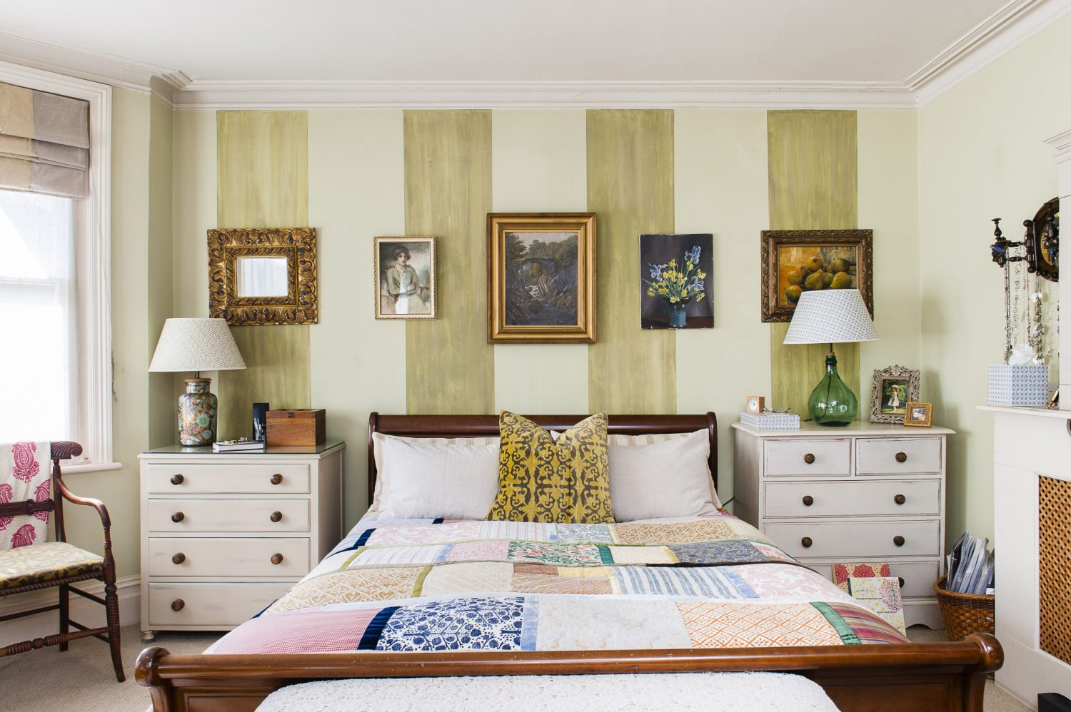 The quilt in the master bedroom is made from squares of fabric that Trudi printed by hand. On a bedside table, a decoupage jar has been turned into a table lamp