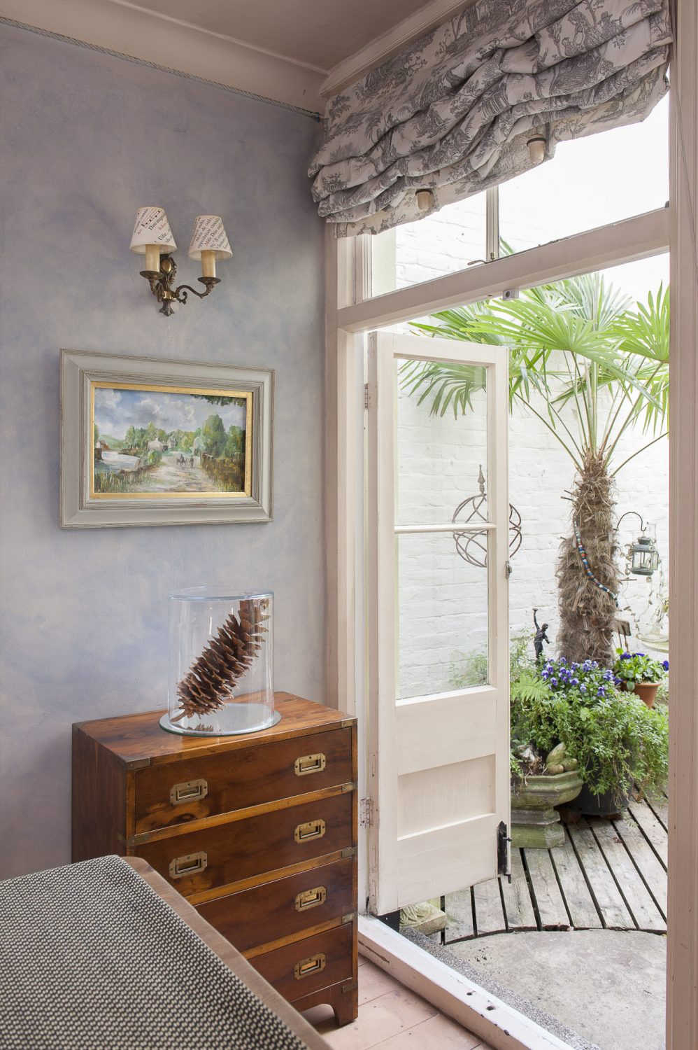 A door from the dining room opens into a pretty courtyard garden
