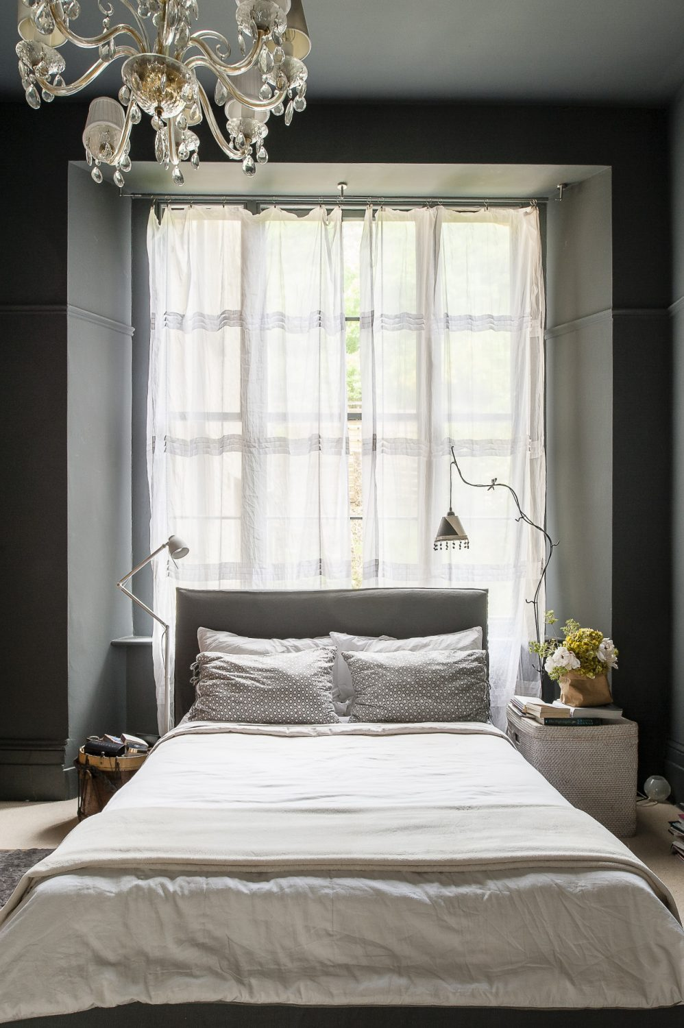 The master bed's grey linen padded headboard is by Paola Navone