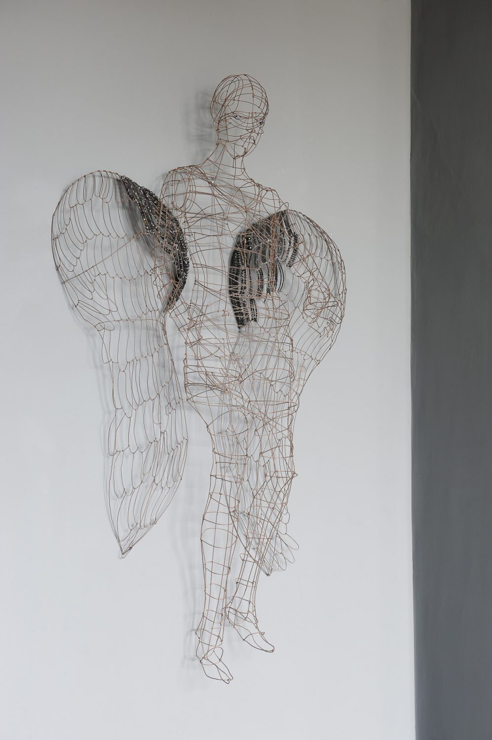 "The wire angel is by French artist Marie Cristophe, bought on a trip to Paris. ""She does a lot of work for the big fashion houses,"" says Karen. ""I saw the angel in a gallery and knew I had to have her in my home."""