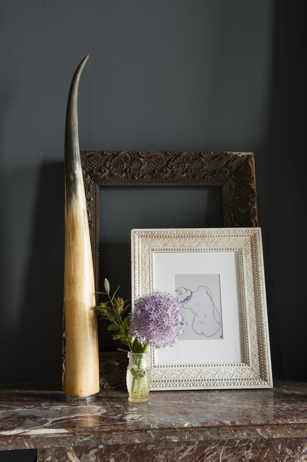 Karen has framed a postcard of a work by a Egon Schiele in an ornate frame on the mantelpiece