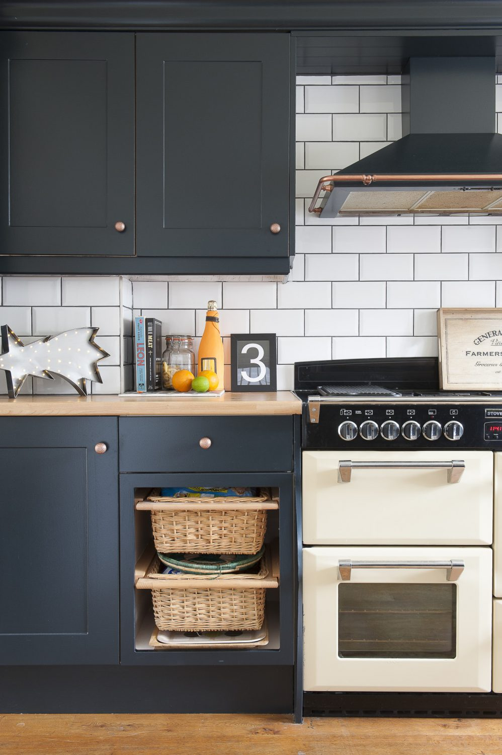 The kitchen units are painted in Farrow & Ball Railings. Lucinda took the knobs and the cooker hood details off and sprayed them copper