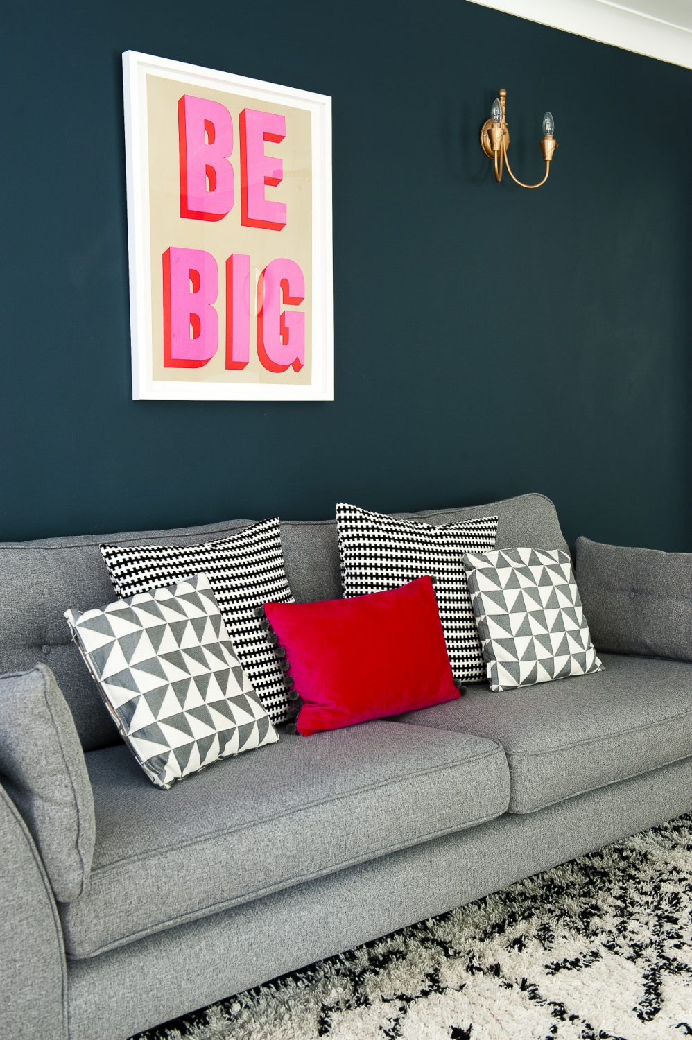 The Be Big poster is from Print Club London and the sofa is French Connection for DFS