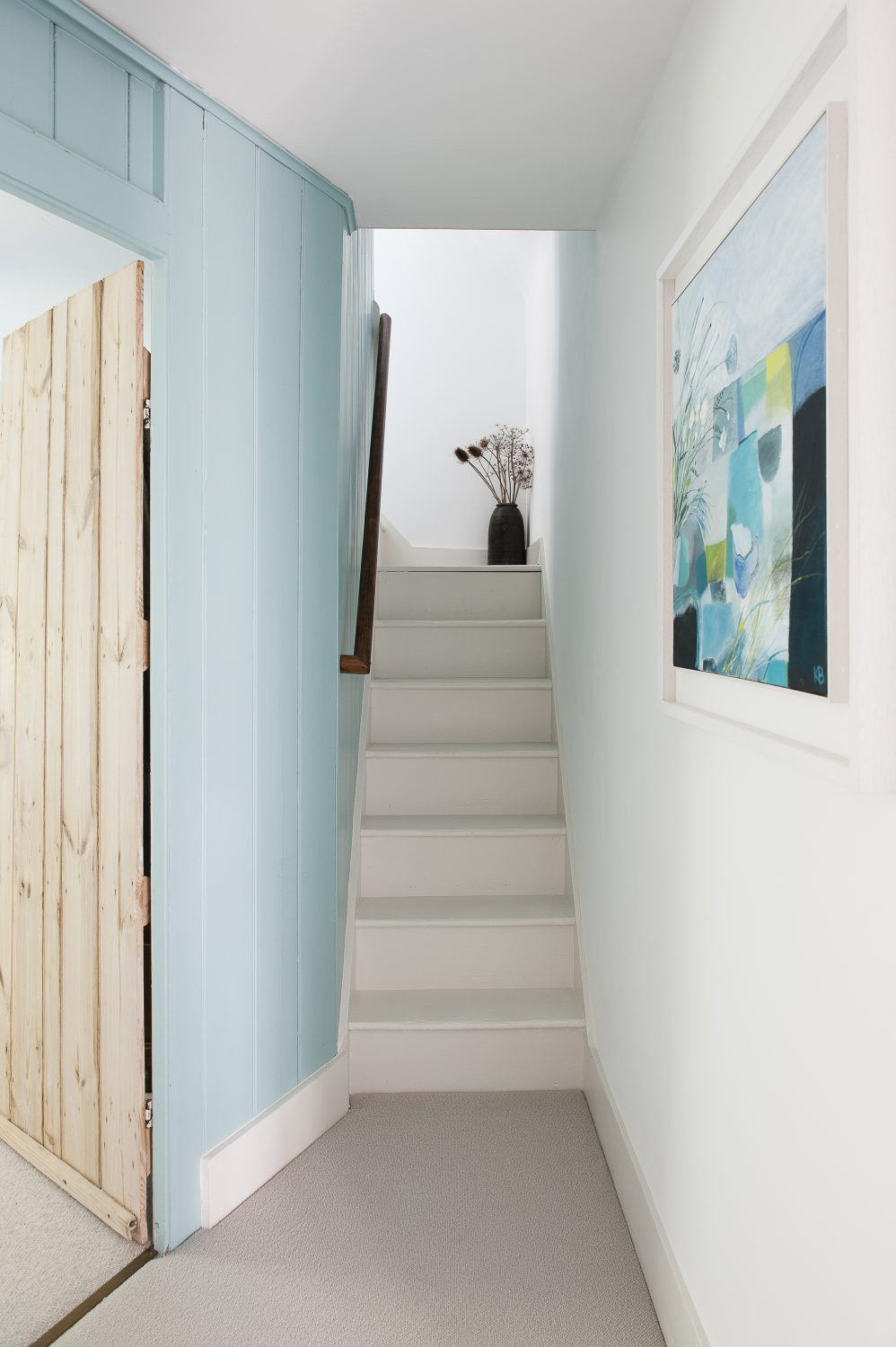 We head upstairs and a pale blue light washes down, bringing an uplifting and serene feeling to the climb, as if we are heading into a coastal sky