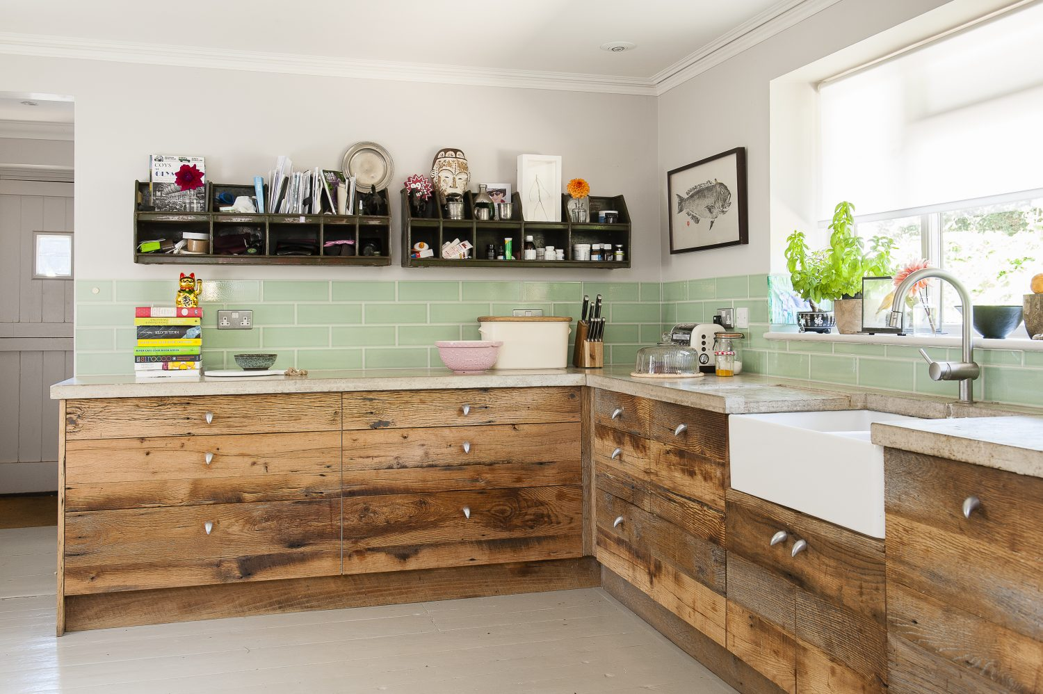 The couple put in a new kitchen with large drawers – instead of cupboards – fronted with American barn oak. The wood has been used to brilliant effect as facings on an off-the-peg kitchen, so it has a hand-built, rustic look