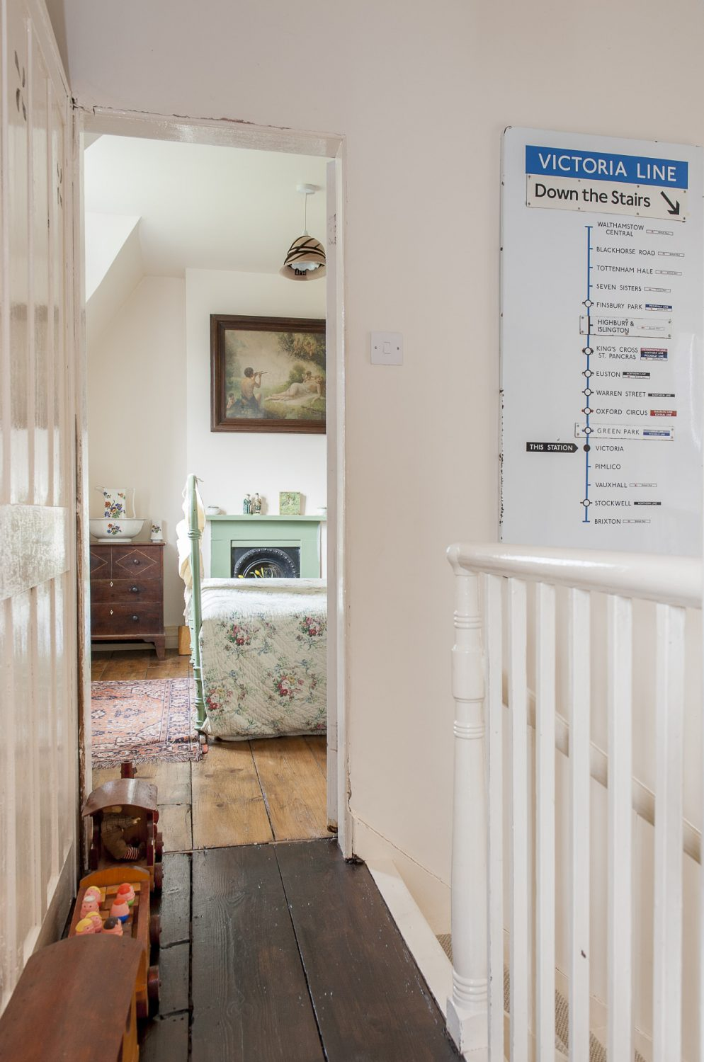 The wall outside the green bedroom features a sign from the Victoria Line, bought at a boot fair in tribute to Queen Victoria, who was monarch when the house was built