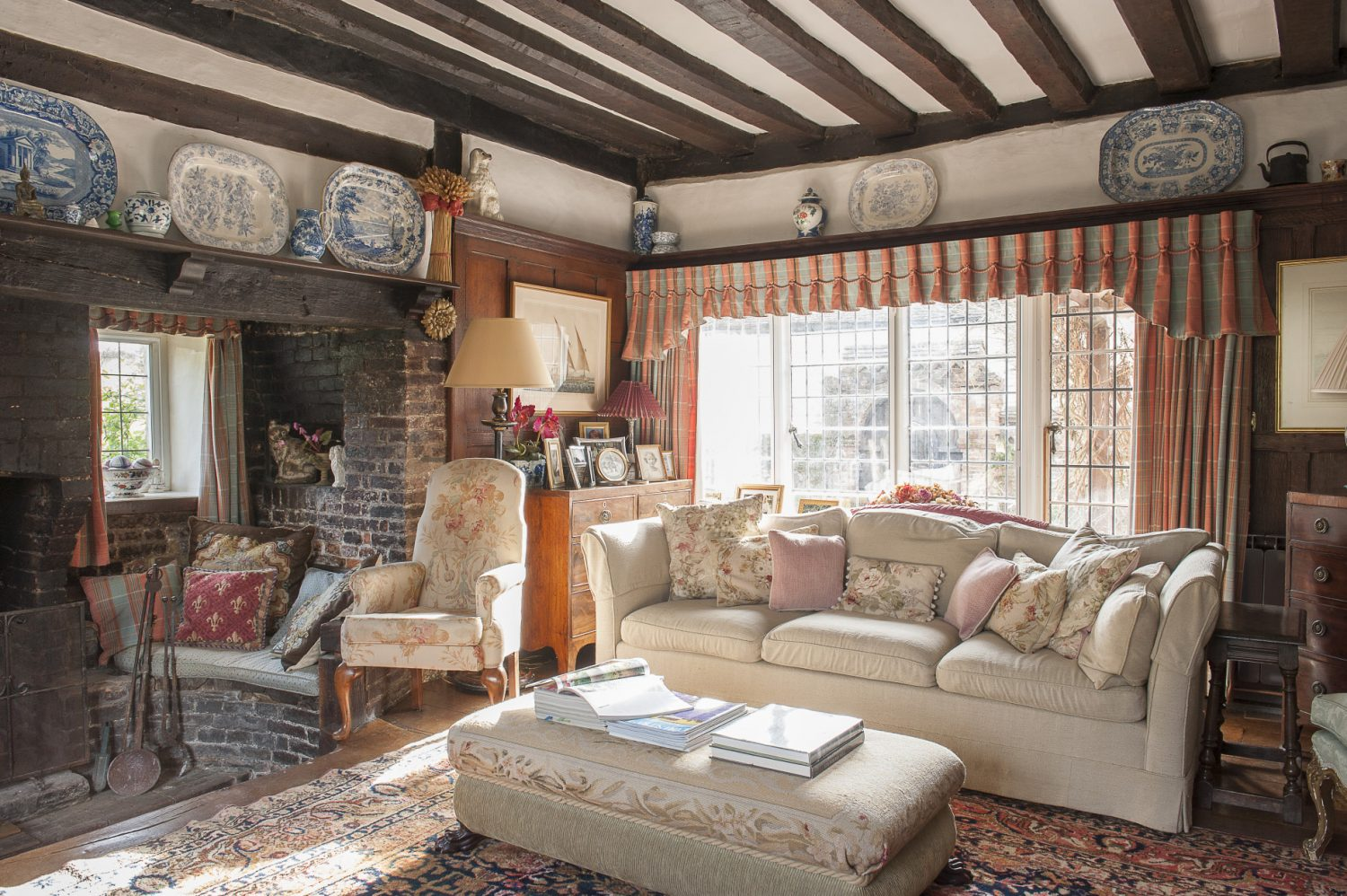 "The front reception room's sunken fireplace was apparently the only warm place to sit. ""My theory is, that the man who did all the work in the 1930s raised the floor – making the fireplace appear sunken,"" says Jane"