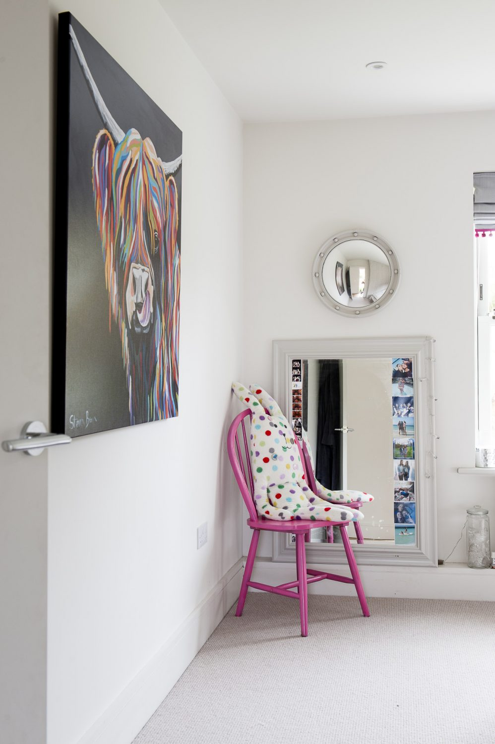 "A selection of pretty mirrors, with painted frames, which Ali refers to as ""granny's mirrors"", are dotted around the room"