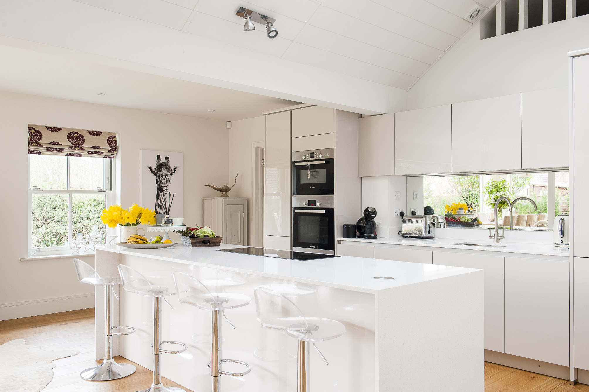 The spacious kitchen was designed and supplied by Martins of Hawkhurst. The panelled vaulted ceiling gives the Kittermasters' home a beach-house feel
