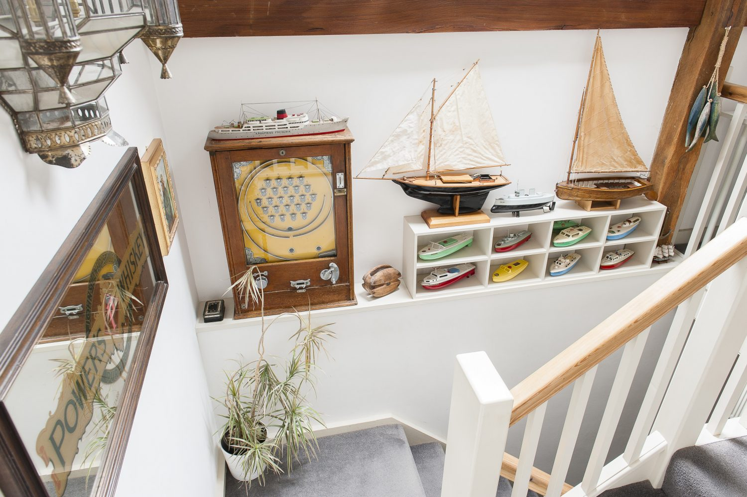 Neatly arranged boats line the ascent to the first floor