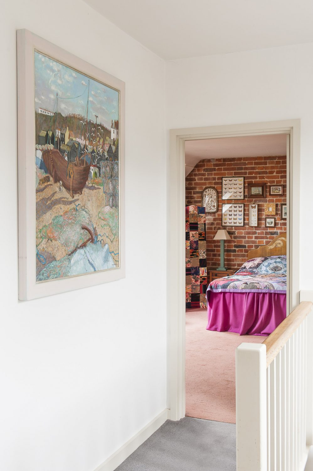 A painting of Hastings by the late Anne-Catherine Phillips takes pride of place at the top of the stairs
