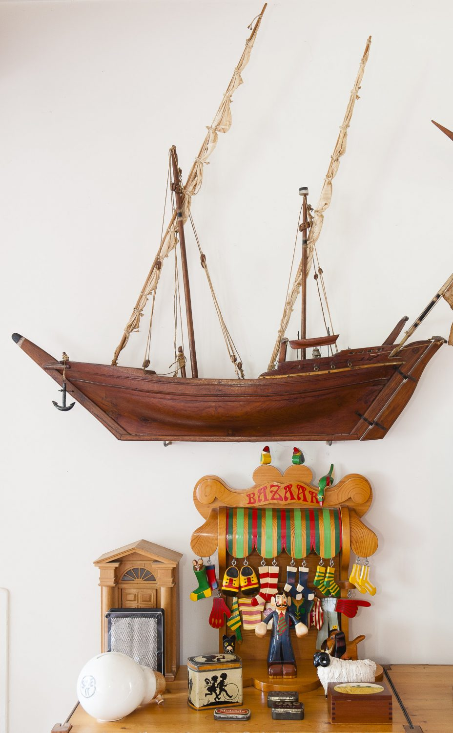 Many of the objects on display in the sitting room belong to Dave, most of them model boats