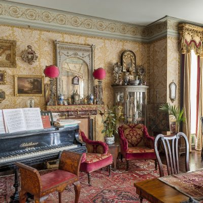 This half of the drawing room, now resplendent with a grand piano – the house's co-owner, Stephen Groves, is a pianist and church organist – was their kitchen