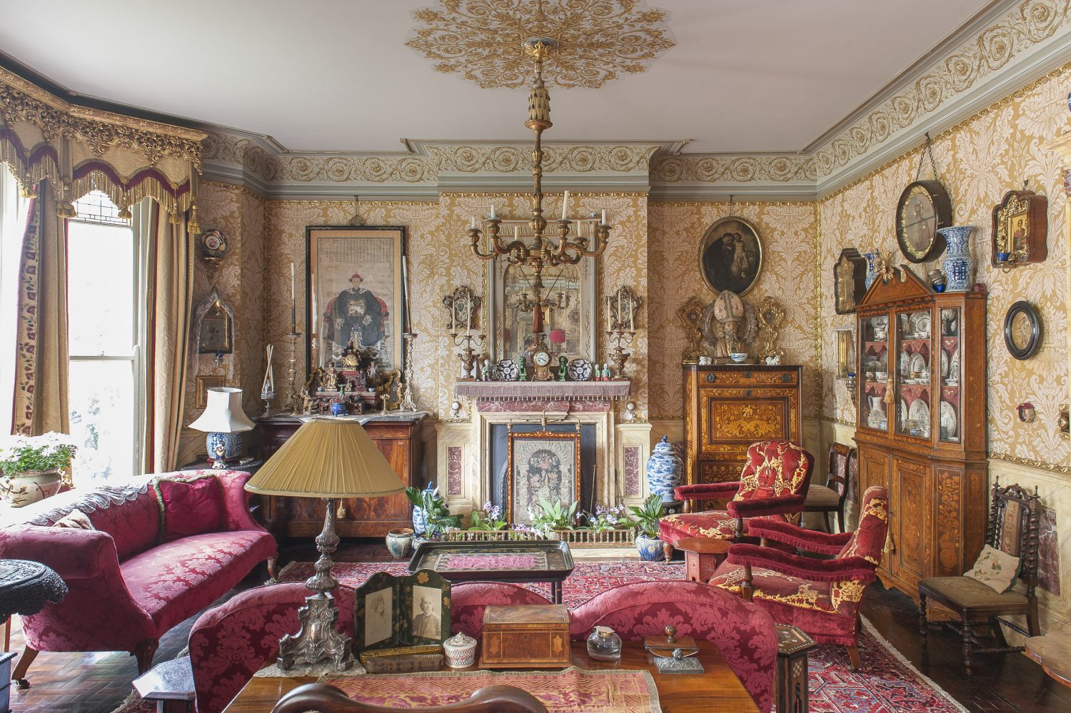 The drawing room is a superb double salon with matching fireplaces at each end