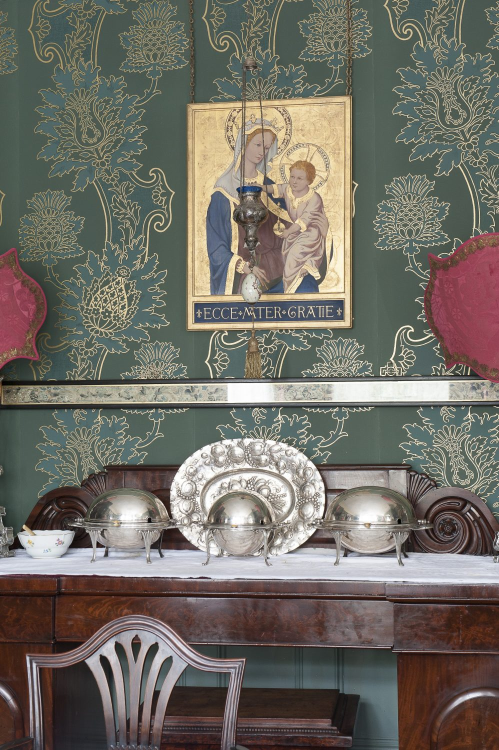 Part of the St. Benedict experience is breakfast in the dining room just across the hall from the drawing room, resplendent with green and gold Watts of Westminster wallpaper and a crystal chandelier, served in silver chafing dishes in the English country house manner