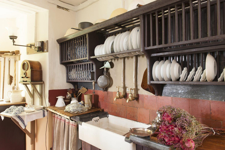 The kitchen features delightful original details