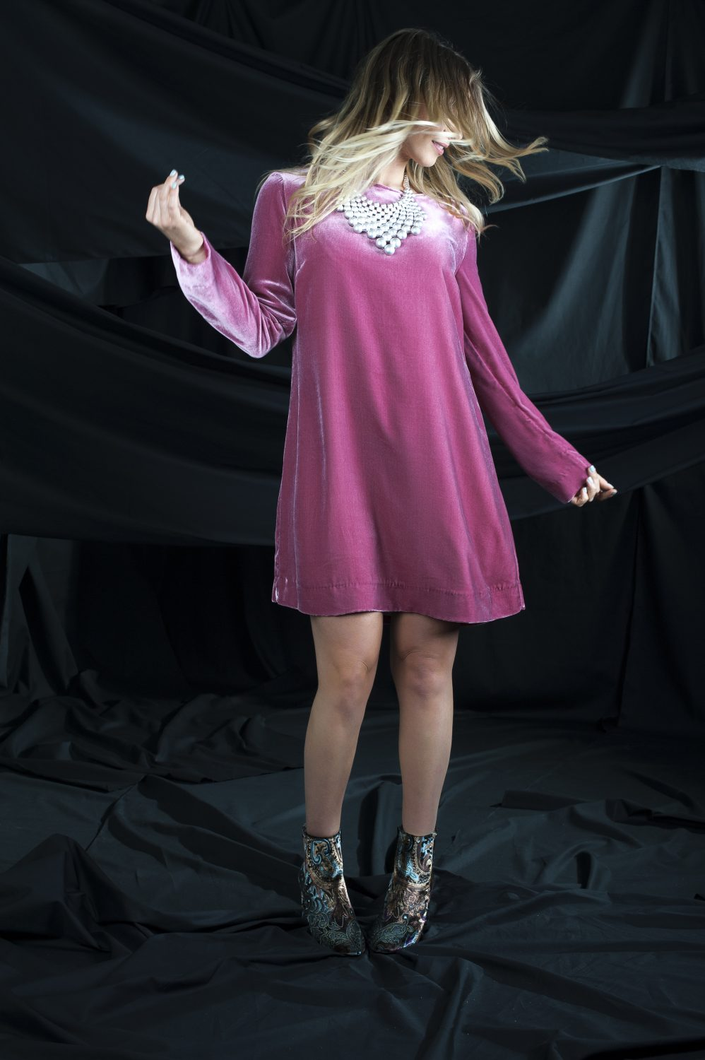 120% velvet dress, £259, Niche, Rye, niche-online.co.uk 01797 225 294; Guglielmo Rotta boots, £245, Golden Boot thegoldenboot.co.uk 01622 752349; pearl necklace, £29, Who's Wearing What Boutique, St Leonards whoswearingwhat-boutique.co.uk 01424 272925