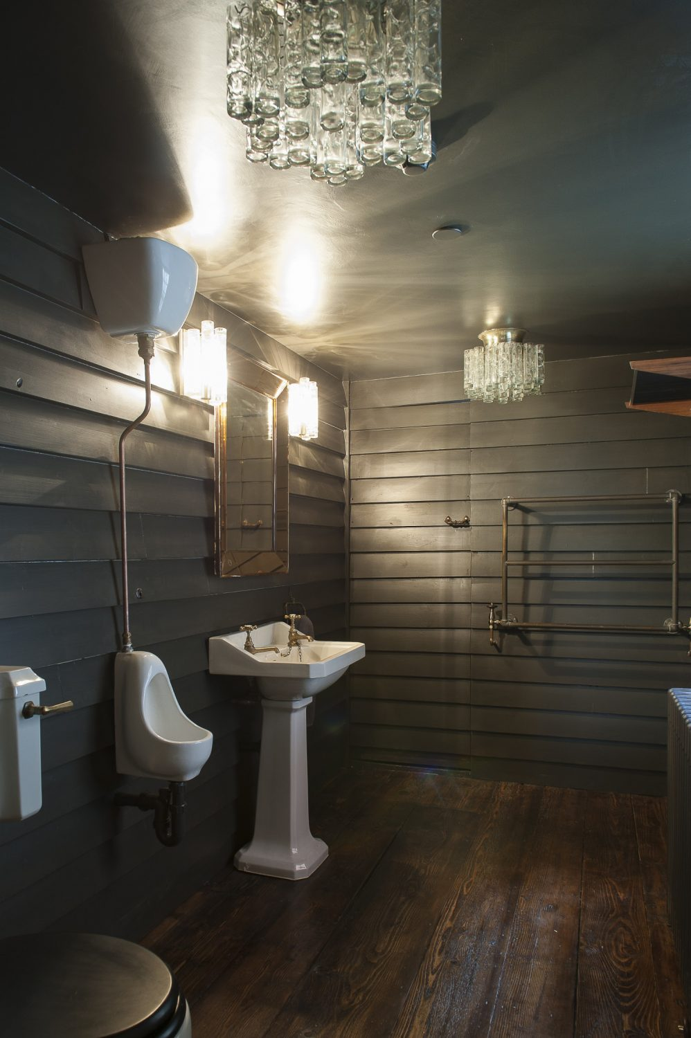 The Net Hut Cloakroom pays tribute to the Old Town fishing community's famous black wooden structures