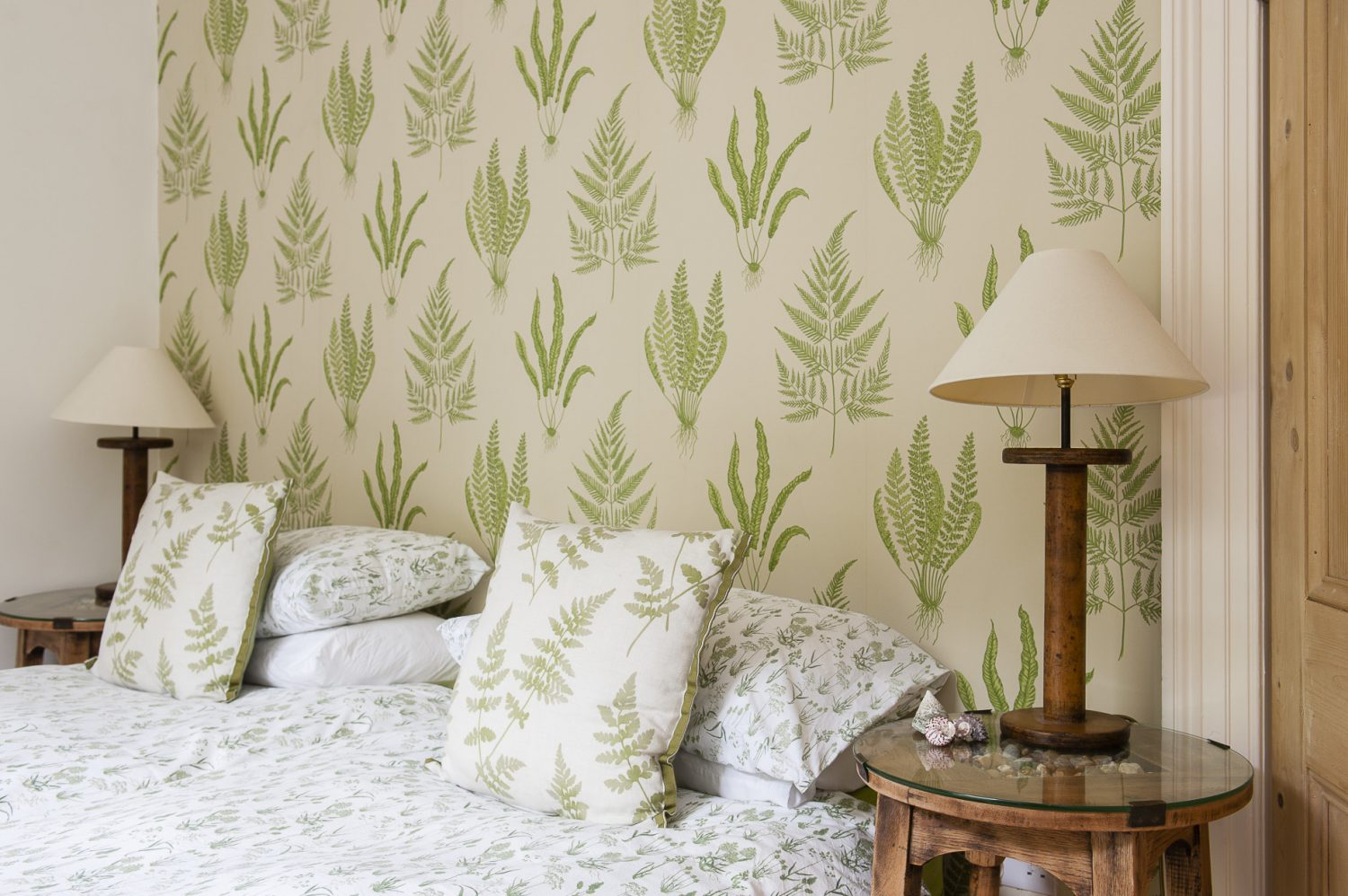 The twin bedroom features a fern theme, inspired by the vegetation in the garden it overlooks