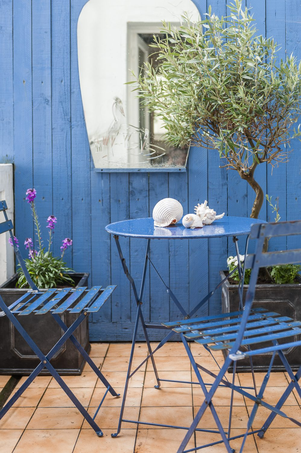 A utility area leads out onto a delightful balustraded balcony, one end panelled with tongue and groove painted a deep marine blue