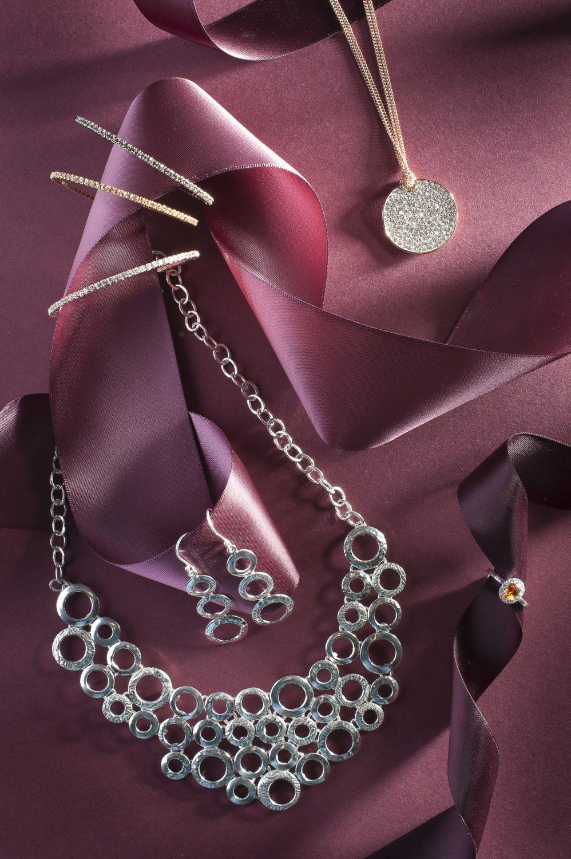 Bangles, £14 each, Park Lane Diamanté Pendant, £24, Melita Boutique, melitaboutique.co.uk; Circle Necklace, £270, Circle Earrings, £40, Garnet Dia Ring, £1,495, G Cornell & Sons, gcornell.co.uk