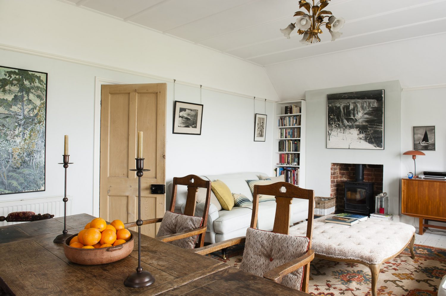 The downstairs flat's dining area is almost a mirror image of the flat above (pictured above), except with antique pieces