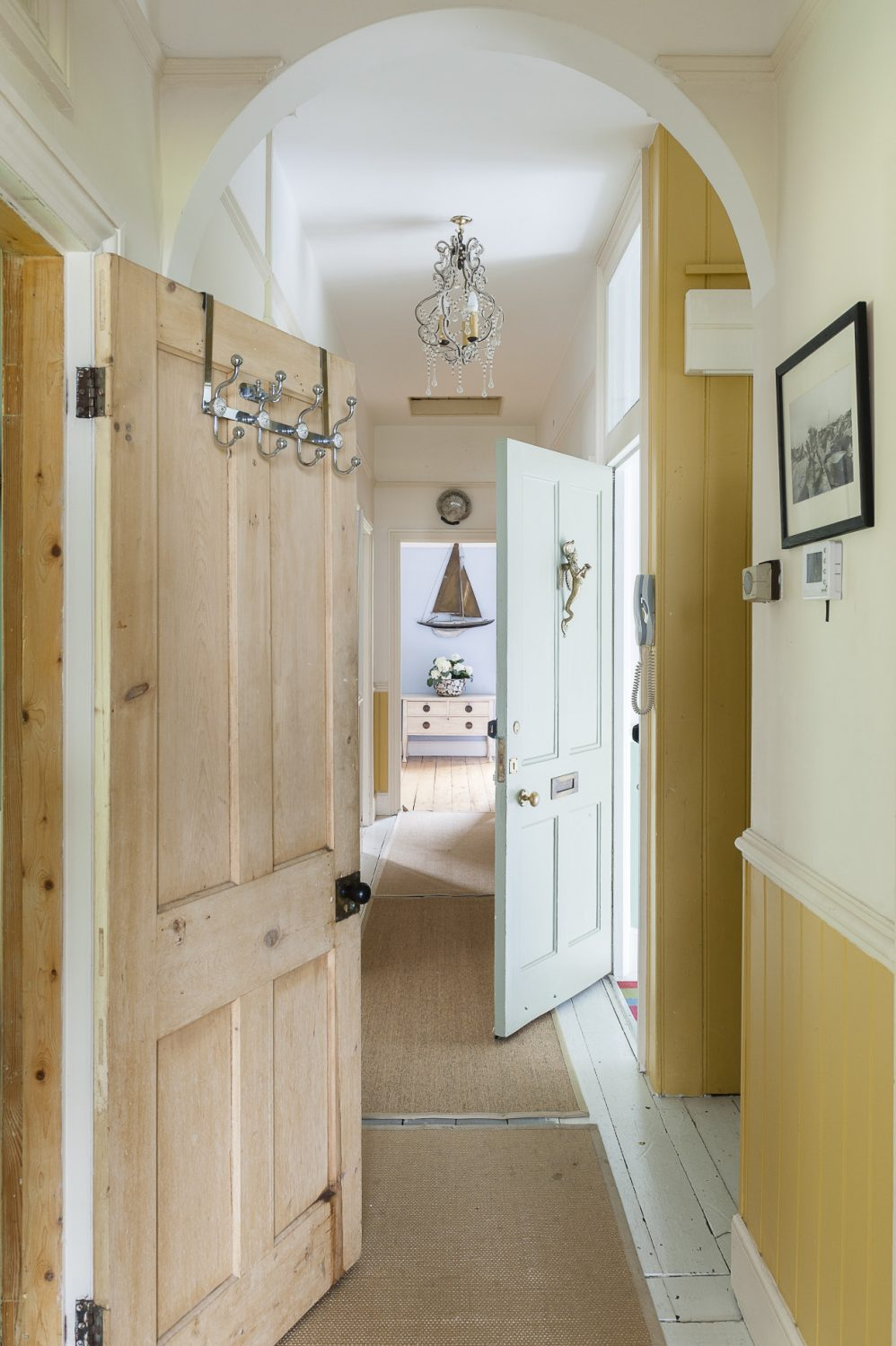 A long corridor passes from the front to the back of the upstairs flat, between the sitting room to the rear bedroom