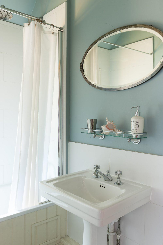 The compact bathroom has a cool nautical feel
