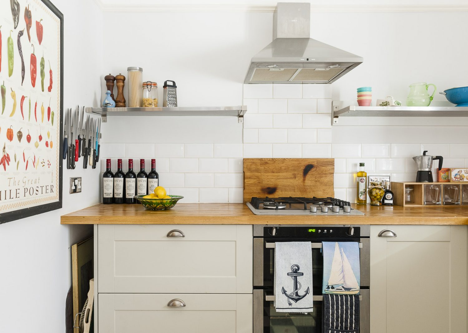 The kitchen tucks neatly into a room at the rear of the flat