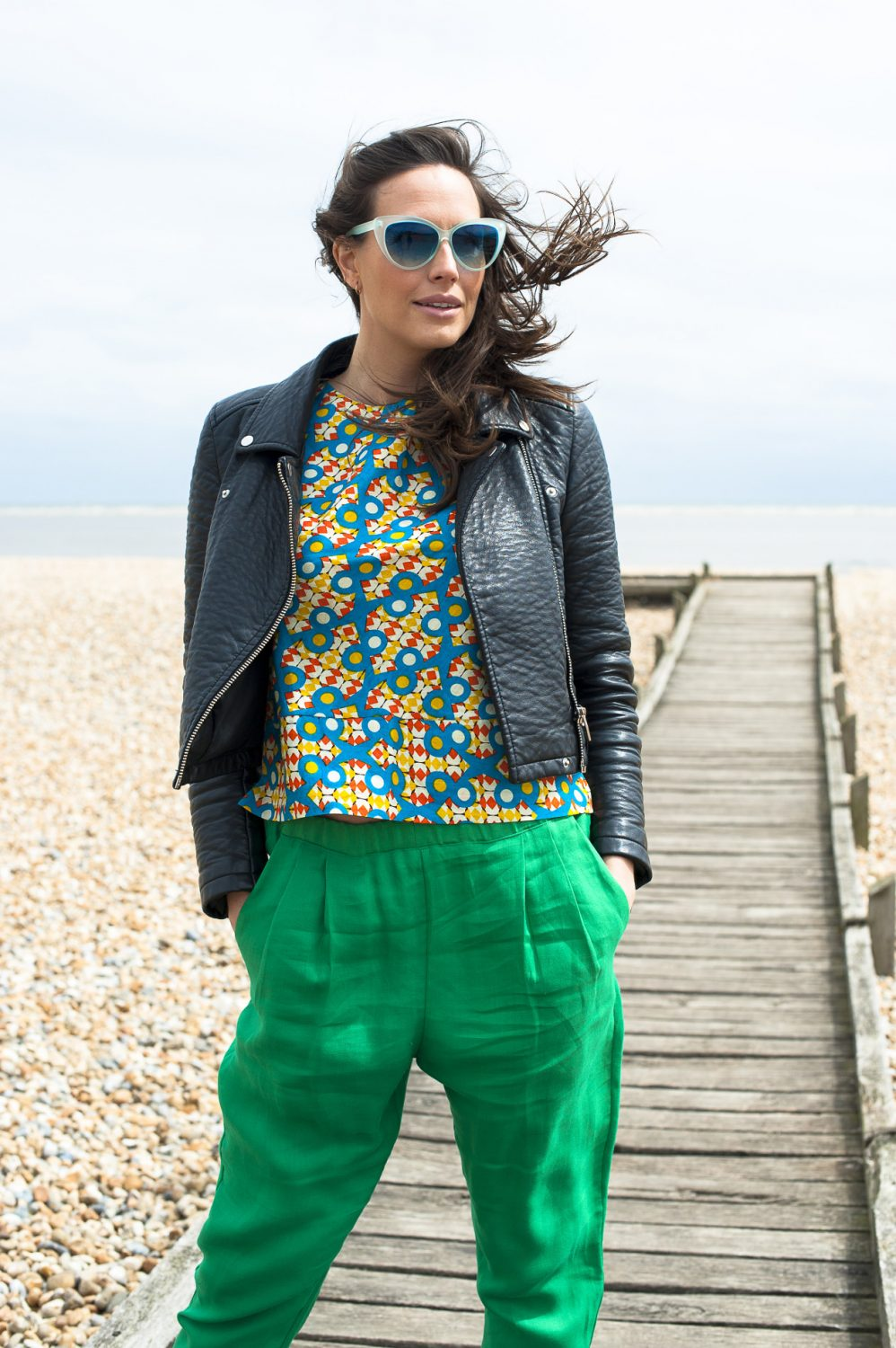 Emin & Paul green trousers, £95, Mayamiko print top, £45, Reyflector sunglasses, £10, Who's Wearing What Boutique, St Leonards whoswearingwhat-boutique.co.uk