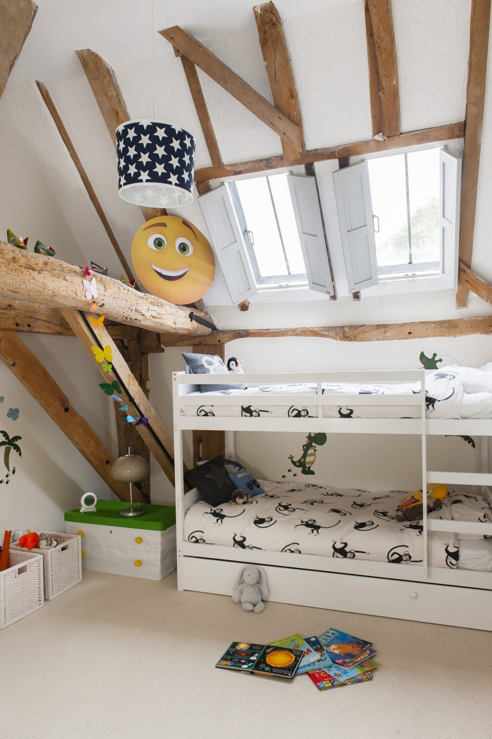 The 300-year-old oak structure of the barn criss-crosses Jay's room at the top of the house