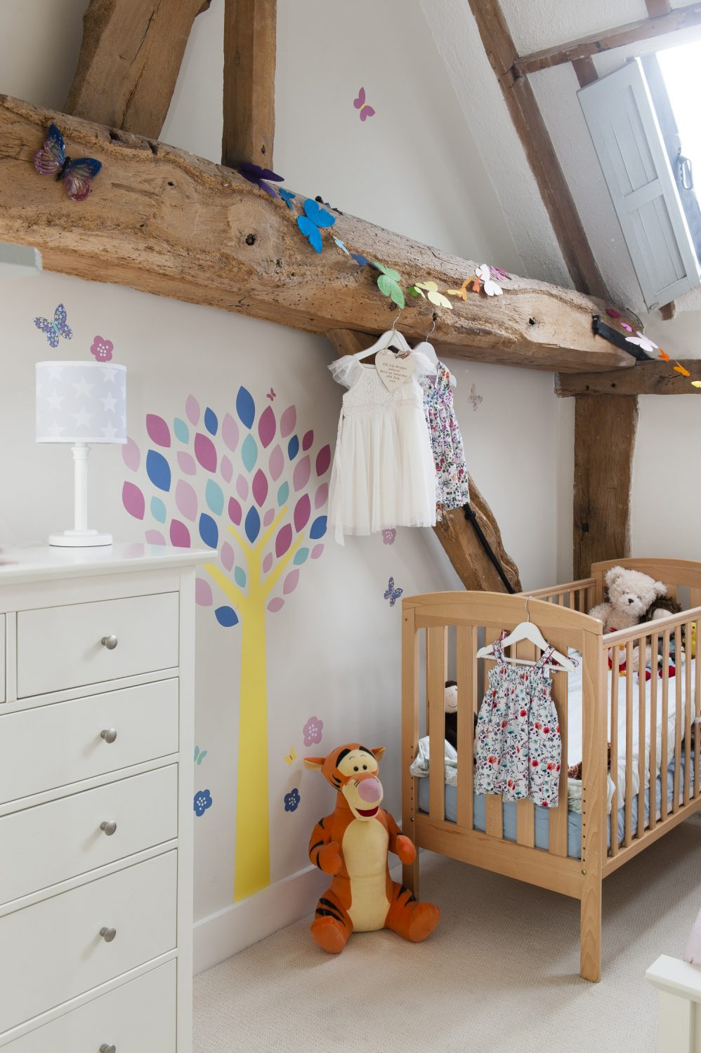 Like her brother's, Elle's room benefits from shuttered skylights